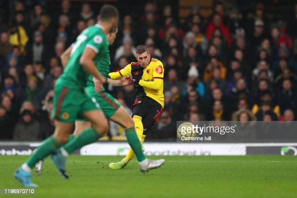 Gerard Deulofeu of Watford scores his sides first goal during the Premier League match between Watford FC and Wolverhampton Wanderers at Vicarage...