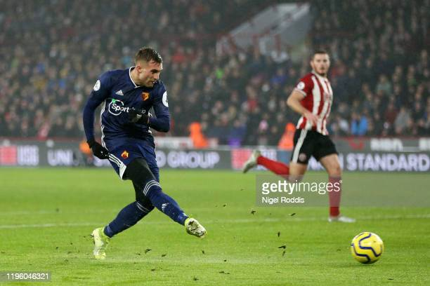 Gerard Deulofeu of Watford scores his team's first goal during the Premier League match between Sheffield United and Watford FC at Bramall Lane on...