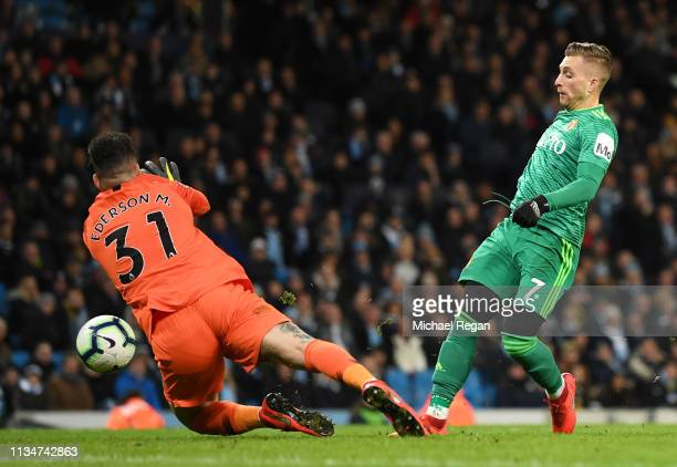 Gerard Deulofeu of Watford scores his team's first goal past Ederson of Manchester City during the Premier League match between Manchester City and...