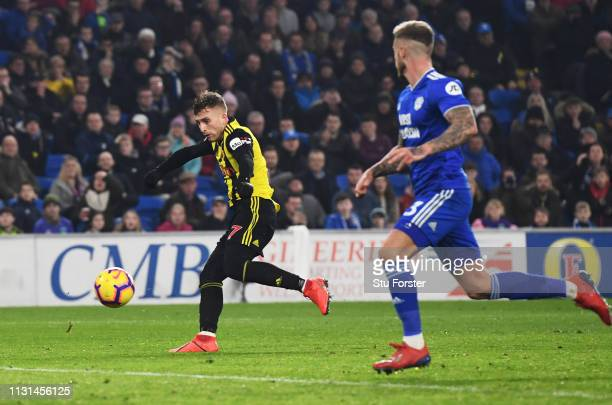 Gerard Deulofeu of Watford scores his team's second goal during the Premier League match between Cardiff City and Watford FC at Cardiff City Stadium...