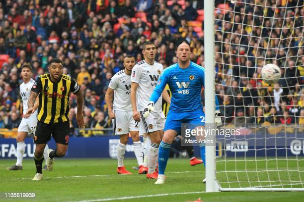 Gerard Deulofeu of Watford scores their 1st goal during the FA Cup Semi Final match between Watford and Wolverhampton Wanderers at Wembley Stadium on...