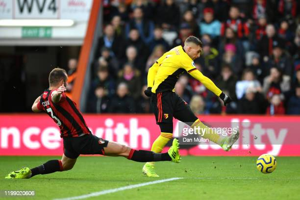 Gerard Deulofeu of Watford shoots on goal under pressure from Steve Cook of AFC Bournemouth during the Premier League match between AFC Bournemouth...