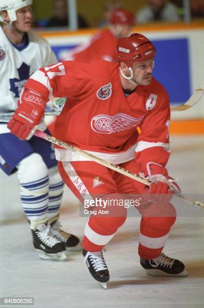 Gerard Gallant of the Detroit Red Wings skates up ice against the Toronto Maple Leafs on October 31 1992 at Maple Leaf Gardens in Toronto Ontario...