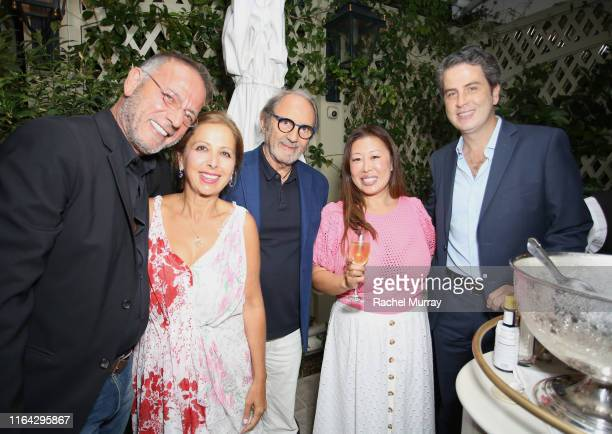 Gerard Guez Karine Ohana Serge Azria Susie Wang and Ariel Ohana attend the Ohana Co LA Summer Party at the Peninsula Hotel on August 19 2019 in...