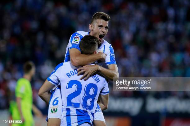 Gerard Gumbau Deportivo Leganes celebrates their victory with teammate Rodrigo Tarin after the La Liga match between CD Leganes and FC Barcelona at...