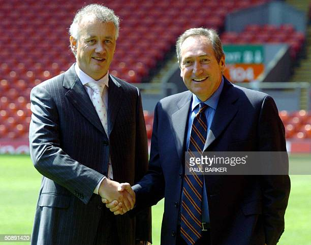 Gerard Houllier shakes hands with Liverpool Chief Executive Rick Parry after the announcement of Houllier's departure from Liverpool Football club at...