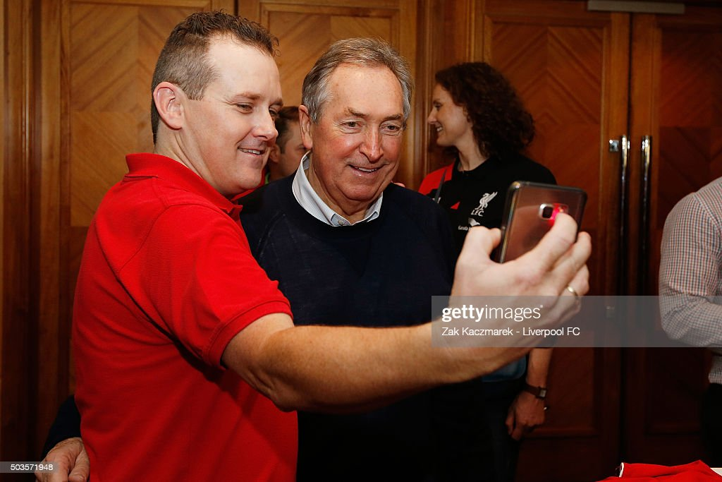 Gerard Houllier signs autographs for fans at a Liverpool Supporters Group event on January 6, 2016 in Sydney, Australia.