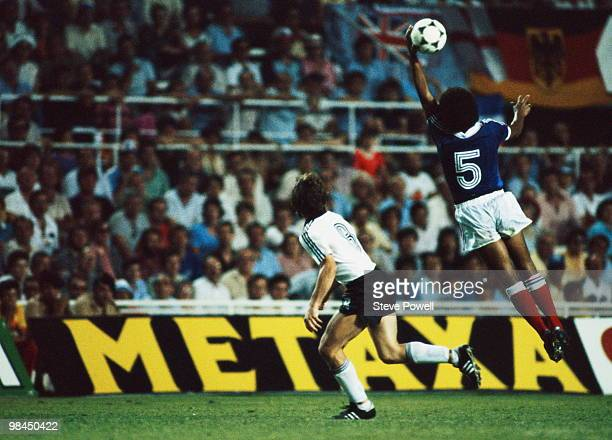 Gerard Janvion of France handles the ball as Klaus Fischer of the Federal Republic of Germany looks on during the 1982 FIFA World Cup semi final on 8...