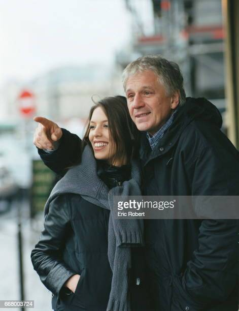Gerard Lenorman and his daughter Clemence pose in front of a restaurant