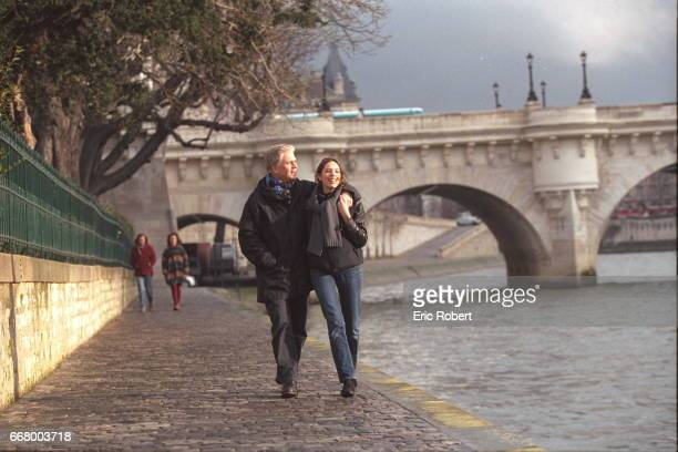 Gerard Lenorman and his daughter Clemence walking by the river Seine
