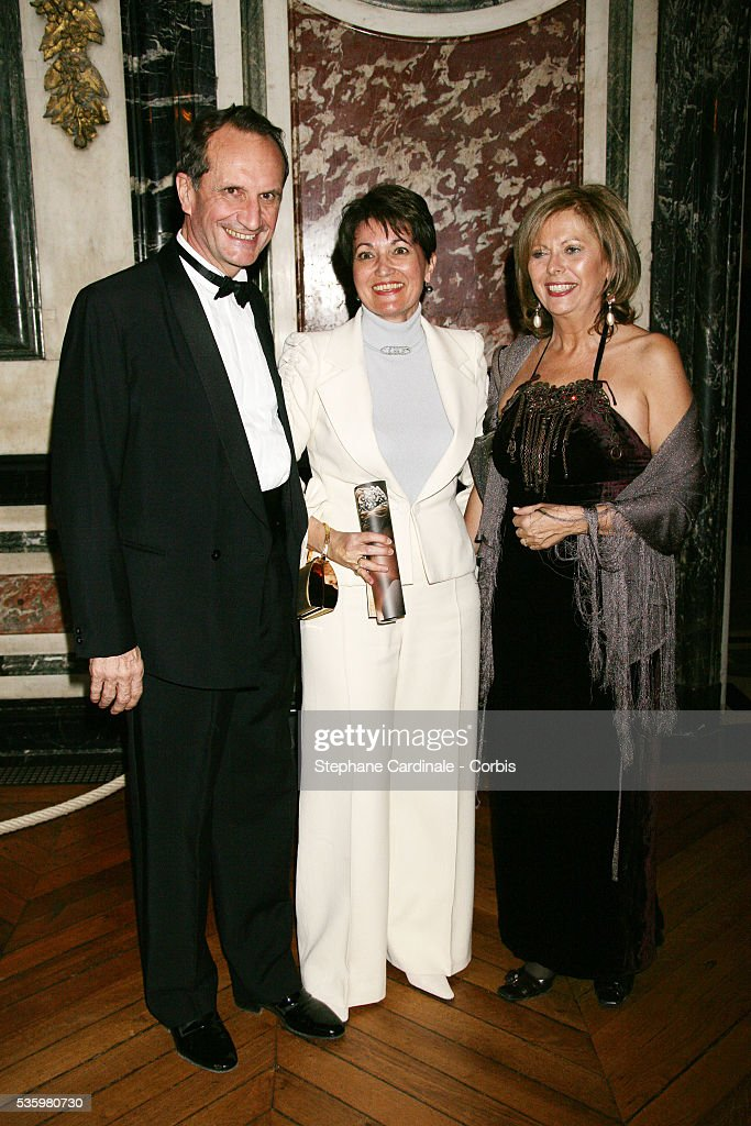 Gerard Longuet and Mrs Raffarin attend the gala for the 'Fondation de l'Enfance' held in Versailles castle.