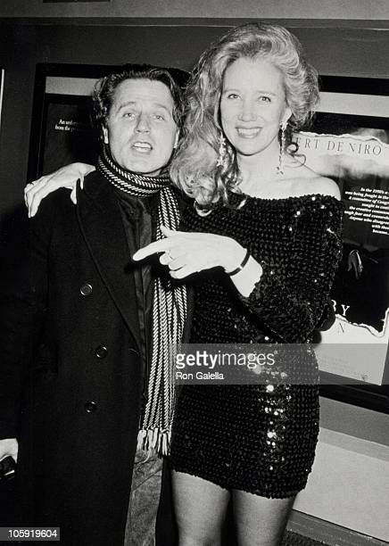 Gerard Malanga and Sally Kirkland during Exhibition of Superstar The Life Times of Andy Warhol at Village East in New York New York United States