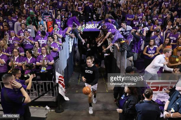 Gerard Martin of the Grand Canyon Antelopes leads teamamtes onto the court before the college basketball game against the St John's Red Storm at...