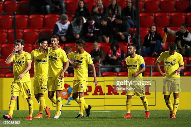 Gerard Moreno Balaguero of Villarreal CF celebrates with his team mates after scoring the winning goal during the international friendly match...