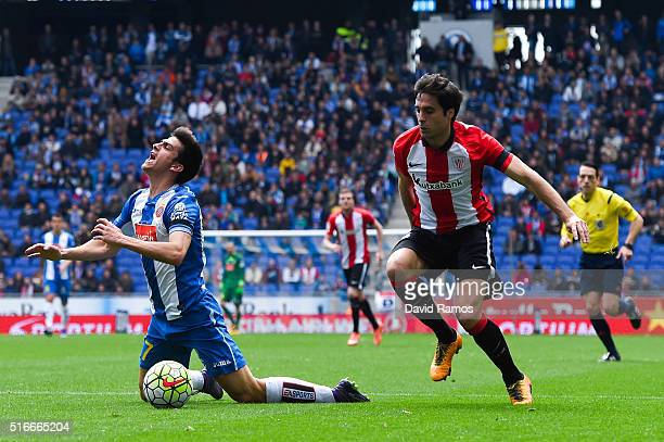 Gerard Moreno of RCD Espanyol is brought down by Xabier Etxeita of Athletic Club during the La Lga match between Real CD Espanyol and Athletic Club...