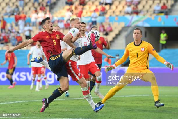 Gerard Moreno of Spain attempts to control the ball whilst under pressure from Tymoteusz Puchacz of Poland during the UEFA Euro 2020 Championship...