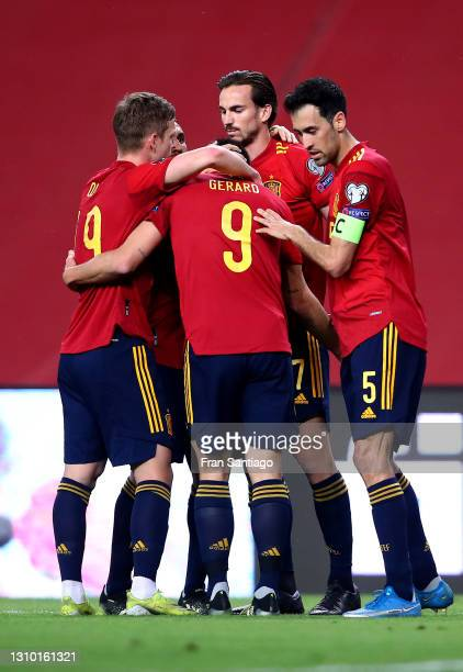 Gerard Moreno of Spain celebrates with teammates Sergio Busquets and Dani Olmo after scoring their team's third goal during the FIFA World Cup 2022...