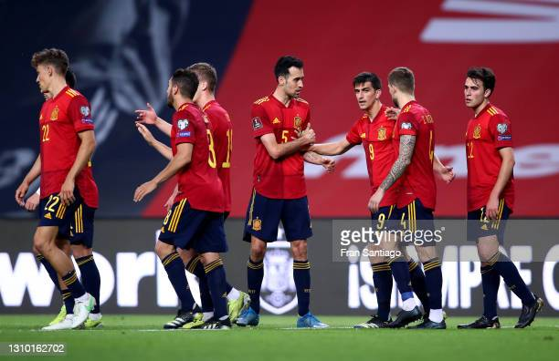 Gerard Moreno of Spain celebrates with teammates Sergio Busquets and Inigo Martinez after scoring their team's third goal during the FIFA World Cup...