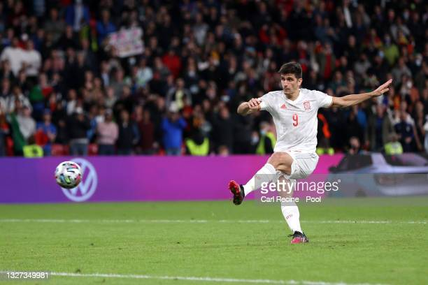 Gerard Moreno of Spain scores their team's second penalty in the penalty shoot out during the UEFA Euro 2020 Championship Semi-final match between...