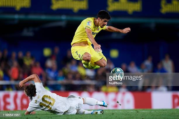 Gerard Moreno of Villarreal and Luka Modric of Real Madrid competes for the ball during the Liga match between Villarreal CF and Real Madrid CF at...