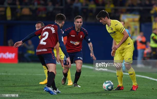 Gerard Moreno of Villarreal and Nacho Vidal of CA Osasuna during the La Liga Santander match between Villarreal and Osasuna at Estadio de la Ceramica...