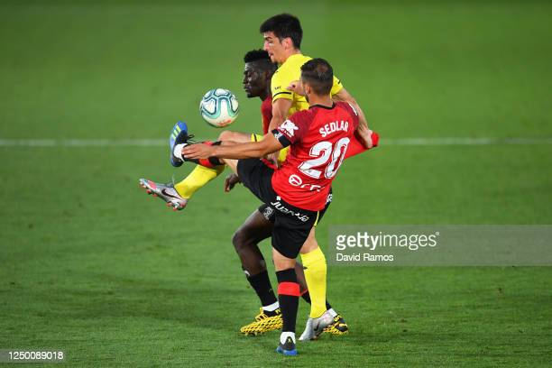 Gerard Moreno of Villarreal battles for possession with Iddrisu Baba of RCD Mallorca and Aleksandar Sedlar of RCD Mallorca during the Liga match...