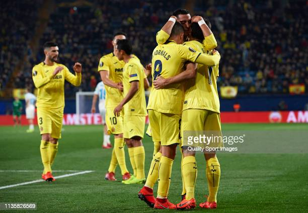 Gerard Moreno of Villarreal celebrates after scoring his team's first goal with his teammates Pablo Fornals Ramiro Funes Mori during the UEFA Europa...