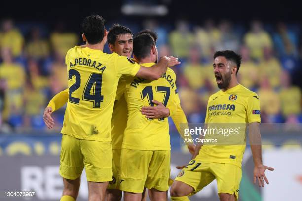 Gerard Moreno of Villarreal celebrates after scoring their team's first goal with his team during the UEFA Europa League Round of 32 match between...
