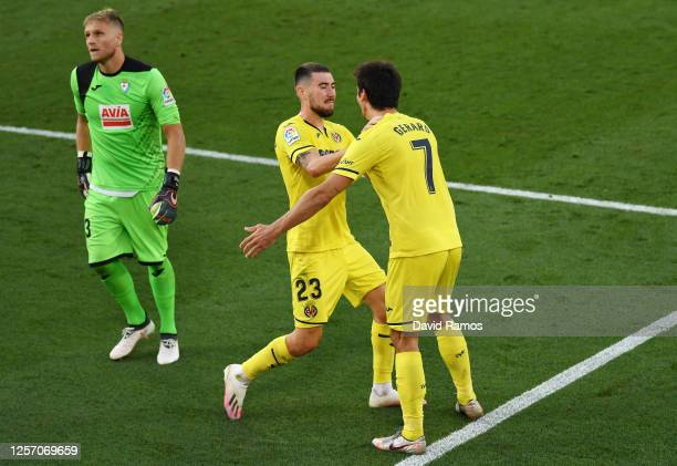 Gerard Moreno of Villarreal celebrates with his teammate Moi Gomez of Villarreal after scoring his team's third goal during the Liga match between...