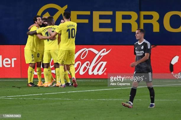 Gerard Moreno of Villarreal celebrates with teammates after scoring his team's first goal during the La Liga Santander match between Villarreal CF...