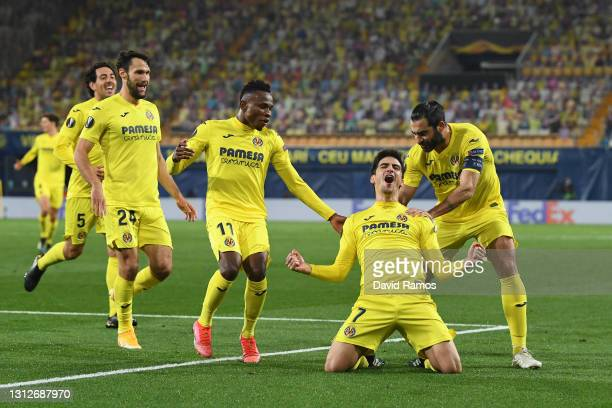 Gerard Moreno of Villarreal celebrates with teammates Alfonso Pedraza, Samuel Chukwueze and Raul Albiol after scoring their team's second goal during...