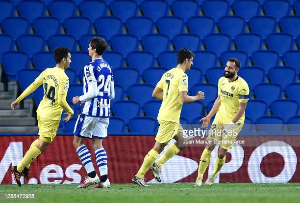 Gerard Moreno of Villarreal celebrates with teammates Mario Gaspar and Manu Trigueros after scoring their team's first goal from the penalty spot...