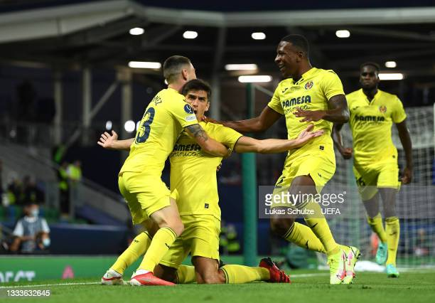 Gerard Moreno of Villarreal celebrates with teammates Moi Gomez and Pervis Estupinan after scoring their team's first goal during the UEFA Super Cup...