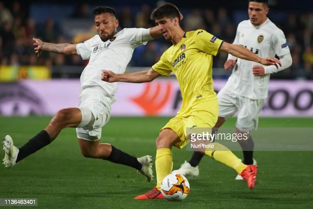 Gerard Moreno of Villarreal CF and Ezequiel Garay of Valencia CF during the UEFA Europa league quarter Final first leg match between Villarreal and...