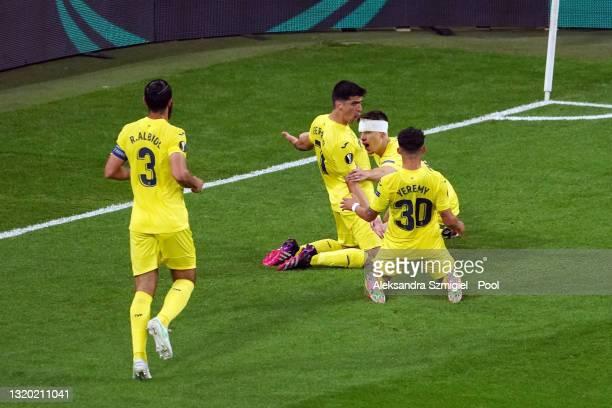 Gerard Moreno of Villarreal CF celebrates after scoring their sides first goal with team mates Juan Foyth and Yeremi Pino during the UEFA Europa...