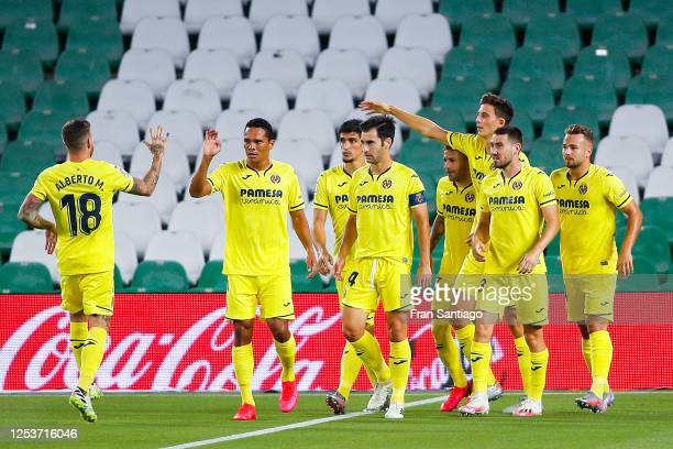Gerard Moreno of Villarreal CF celebrates with his team mate Moi Gomez of Villarreal CF after scoring his team's first goal from the penalty spot...