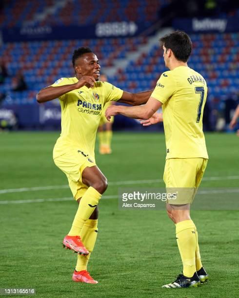 Gerard Moreno of Villarreal CF celebrates with his teammate Samuel Chukwueze after scoring his team's second goal during the La Liga Santander match...