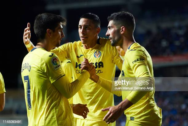 Gerard Moreno of Villarreal CF celebrates with his teammates Alvaro Gonzalez and Ramiro Funes Mori after scoring the opening goal during the La Liga...