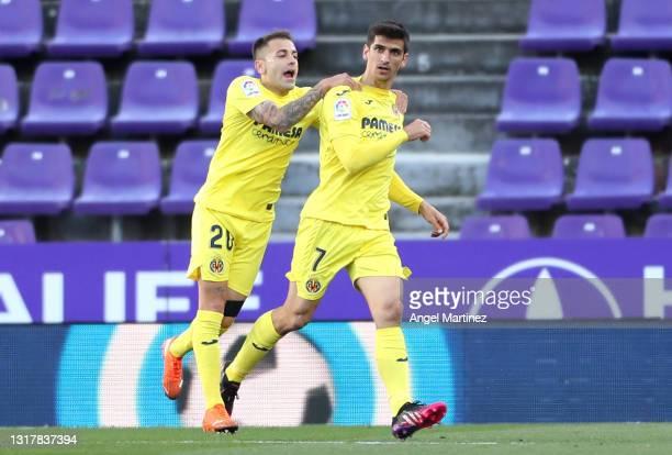 Gerard Moreno of Villarreal CF celebrates with Ruben Pena after scoring their side's first goal during the La Liga Santander match between Real...