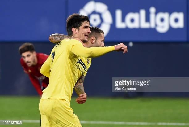 Gerard Moreno of Villarreal CF celebrates with teammate Ruben Pena after scoring his team's third goal during the La Liga Santander match between...