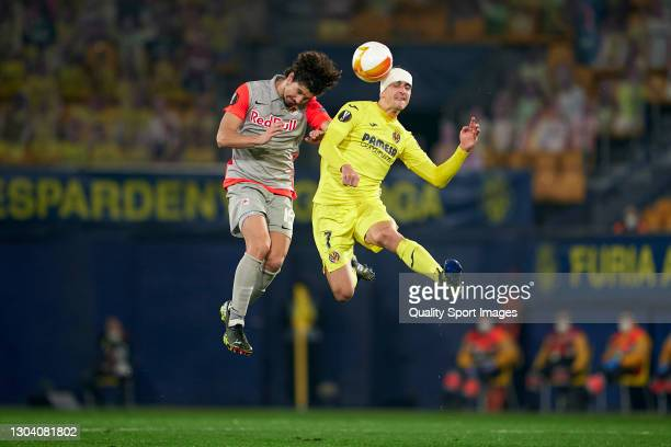 Gerard Moreno of Villarreal CF competes for the ball with Andre Ramalho of RB Salzburg during the UEFA Europa League Round of 32 match between...