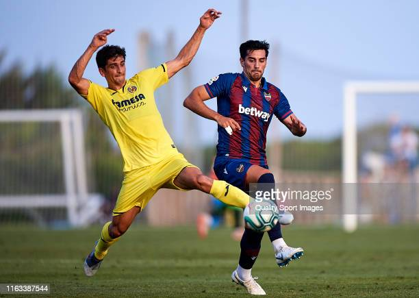 Gerard Moreno of Villarreal CF competes for the ball with Chema of Levante during a PreSeason Friendly match between Villarreal and Levante on July...