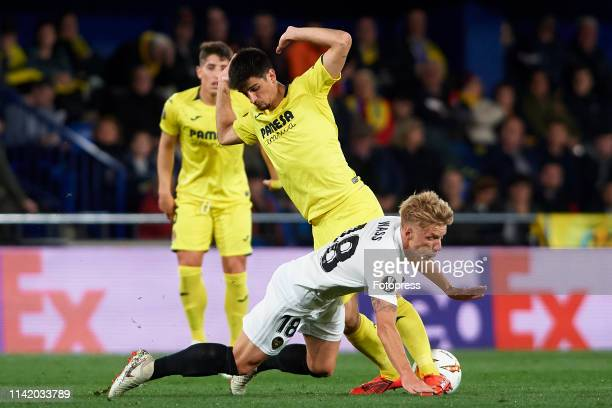 Gerard Moreno of Villarreal CF competes for the ball with Daniel Wass of Valencia CF during the UEFA Europa League Quarter Final First Leg match...
