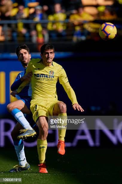 Gerard Moreno of Villarreal CF competes for the ball with Didac Vila of RCD Espanyol during the La Liga match between Villarreal CF and RCD Espanyol...