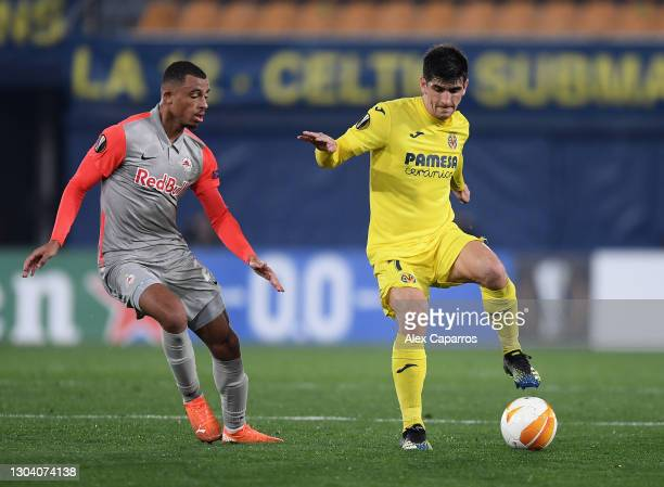 Gerard Moreno of Villarreal CF is challenged by Antoine Bernede of RB Salzburg during the UEFA Europa League Round of 32 match between Villarreal CF...