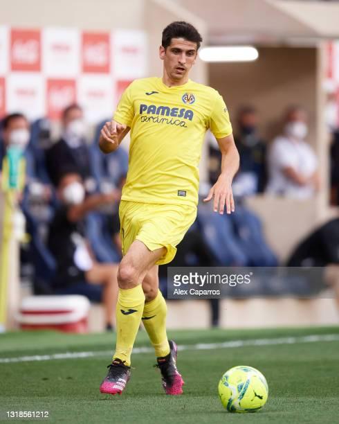 Gerard Moreno of Villarreal CF runs with the ball during the La Liga Santander match between Villarreal CF and Sevilla FC at Estadio de la Ceramica...