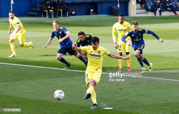 Gerard Moreno of Villarreal CF scores their side's first goal from the penalty spot during the La Liga Santander match between Villarreal CF and...