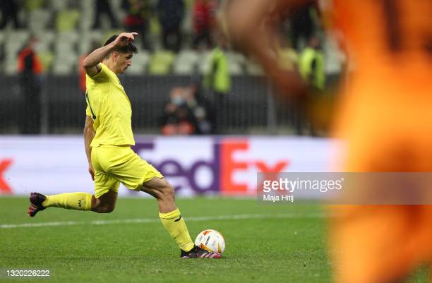 Gerard Moreno of Villarreal CF scores their team's first penalty in the penalty shoot out during the UEFA Europa League Final between Villarreal CF...