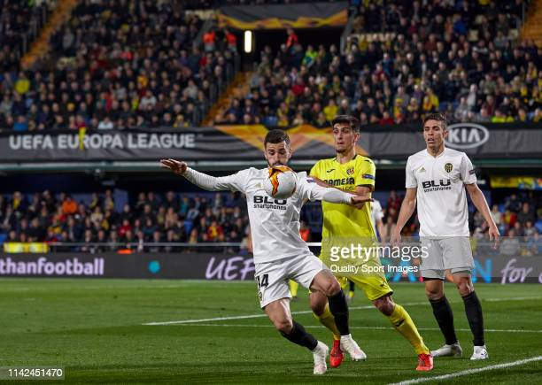 Gerard Moreno of Villarreal competes for the ball with Jose Luis Gaya and Gabriel Paulista of Valencia during the UEFA Europa League Quarter Final...