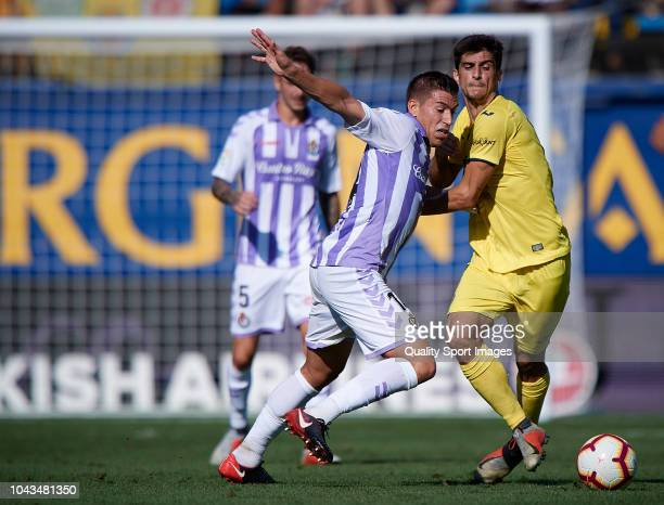 Gerard Moreno of Villarreal competes for the ball with Ruben Alcaraz of Real Valladolid during the La Liga match between Villarreal CF and Real...